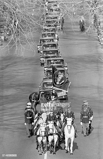 The caisson carrying the late President John F Kennedy leads the funeral procession on November 22 on its way from St Matthew's Cathedral to...