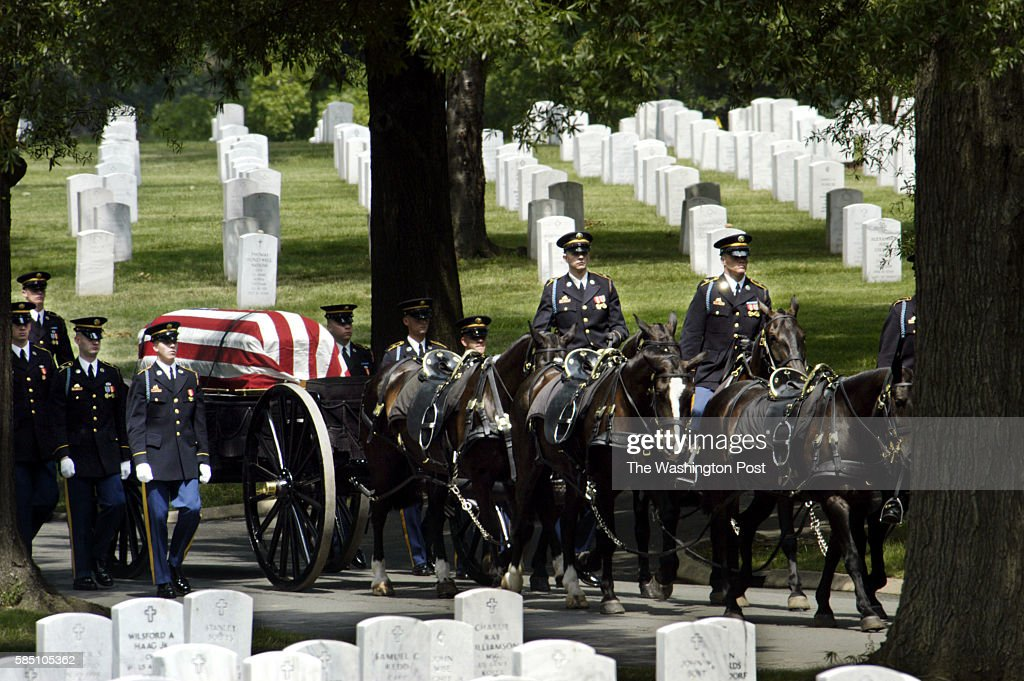 FILE The caisson escorts fallen US Army Cpt Humayun Saqib Muazzam Khan to his gravesite in advance of his funeral at Arlington National Cemetery in...
