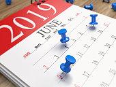 The calendar on the desk. Focused image