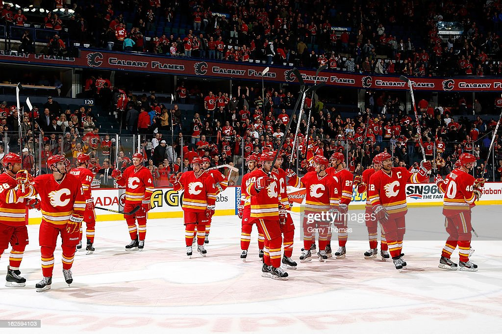 The Calgary Flames acknowledge the crowd after a 5-4 win against the Phoenix Coyotes on February 24, 2013 at the Scotiabank Saddledome in Calgary, Alberta, Canada.