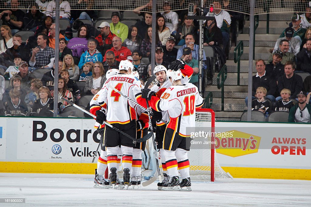 The Calgary Flames celebrate a goal against the Dallas Stars at the American Airlines Center on February 17, 2013 in Dallas, Texas.