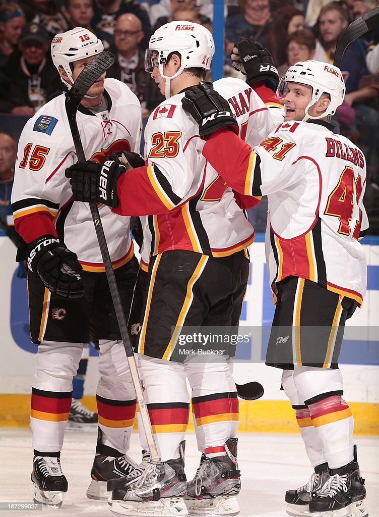 The Calgary Flames celebrate a goal against the St. Louis Blues on November 7, 2013 at Scottrade Center in St. Louis, Missouri.