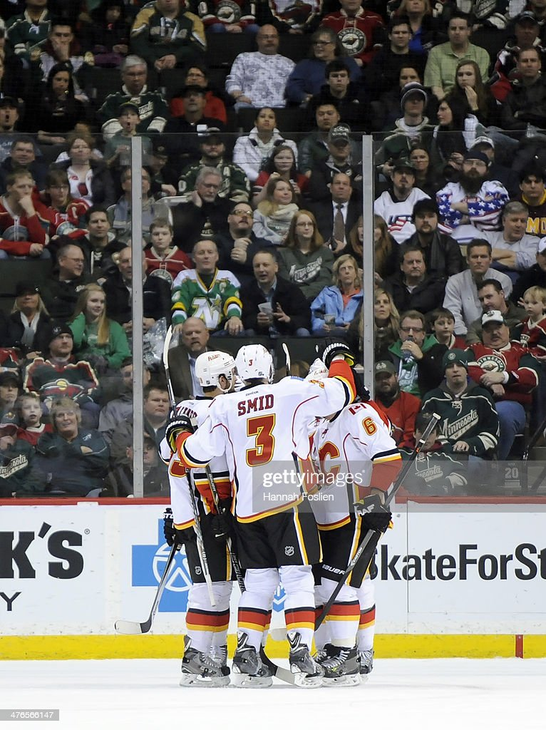 The Calgary Flames celebrate a goal by Mike Cammalleri #13 against the Minnesota Wild during the second period of the game on March 3, 2014 at Xcel Energy Center in St Paul, Minnesota.