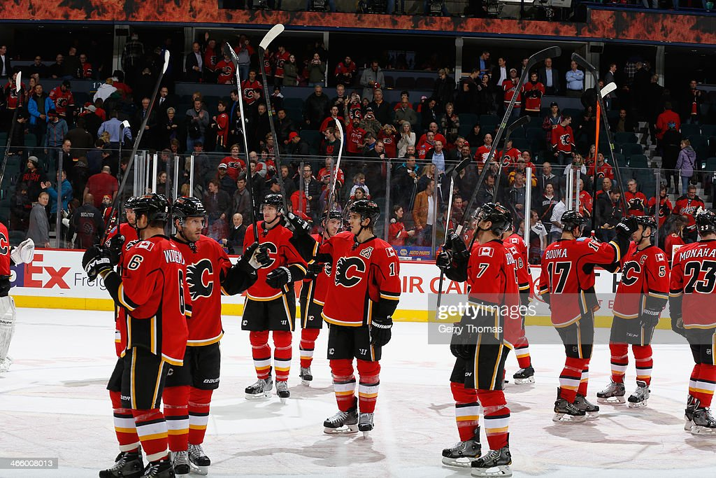 The Calgary Flames celebrate a win against the San Jose Sharks at Scotiabank Saddledome on January 30, 2014 in Calgary, Alberta, Canada.