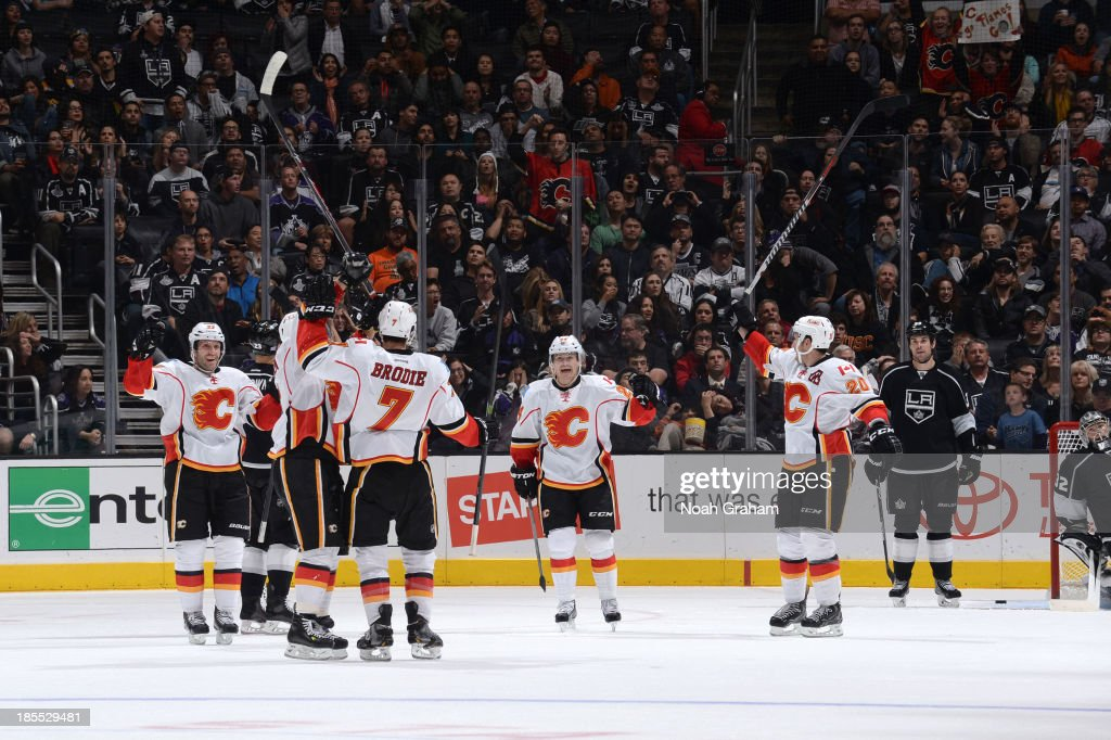 The Calgary Flames celebrate after a goal against the Los Angeles Kings at Staples Center on October 21, 2013 in Los Angeles, California.