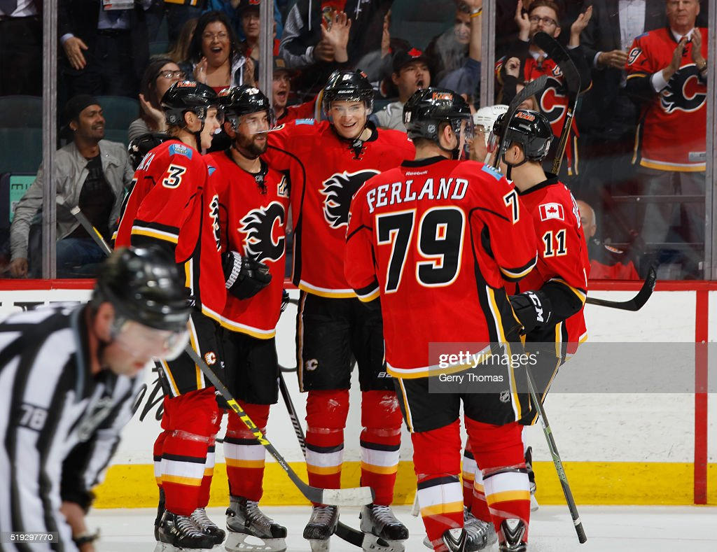 The Calgary Flames celebrate after a goal against the Los Angeles King at Scotiabank Saddledome on April 5, 2016 in Calgary, Alberta, Canada.