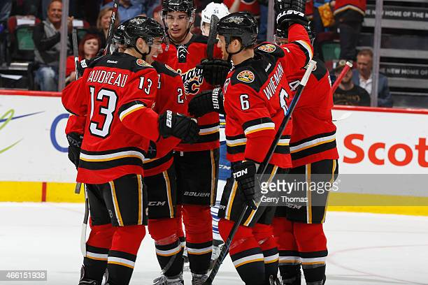 The Calgary Flames celebrate after a goal against the Toronto Maple Leafs at Scotiabank Saddledome on March 13 2015 in Calgary Alberta Canada
