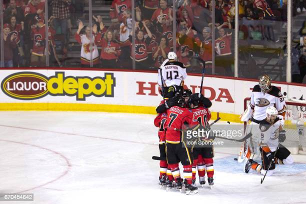 The Calgary Flames celebrate scoring their first goal of the game in the second period during game 4 of the first round of the Stanley Cup Playoffs...