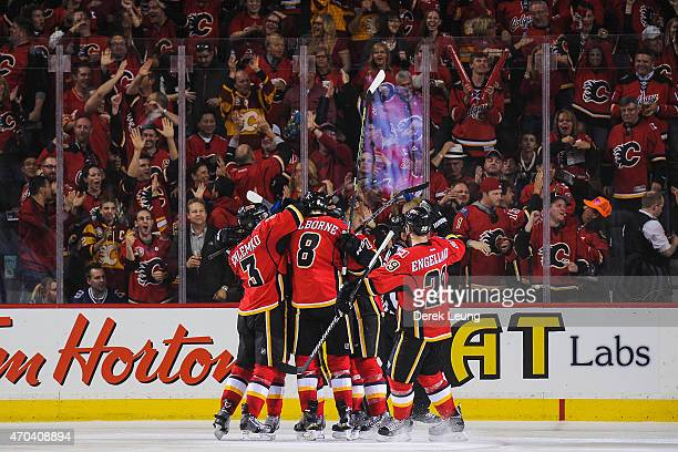 The Calgary Flames celebrate the goal of Sam Bennett against the Vancouver Canucks in Game Three of the Western Quarterfinals during the 2015 NHL...