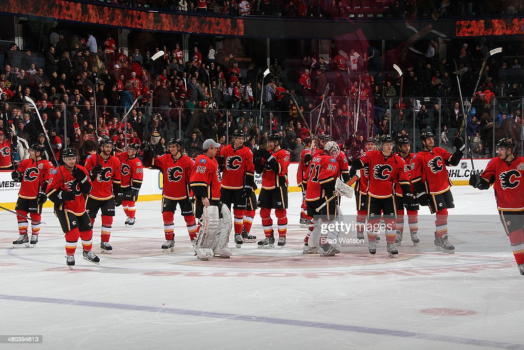 The Calgary Flames do a stick salute after winning in a game against the San Jose Sharks at Scotiabank Saddledome on March 24, 2014 in Calgary, Alberta, Canada.