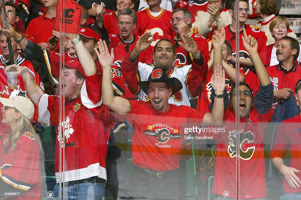 The Calgary Flames fans celebrate during Game six of the 2004 NHL Western Conference Finals against the San Jose Sharks at the Pengrowth Saddledome on May 19, 2004 in Calgary, Alberta. The Flames defeated the Sharks 3-1.