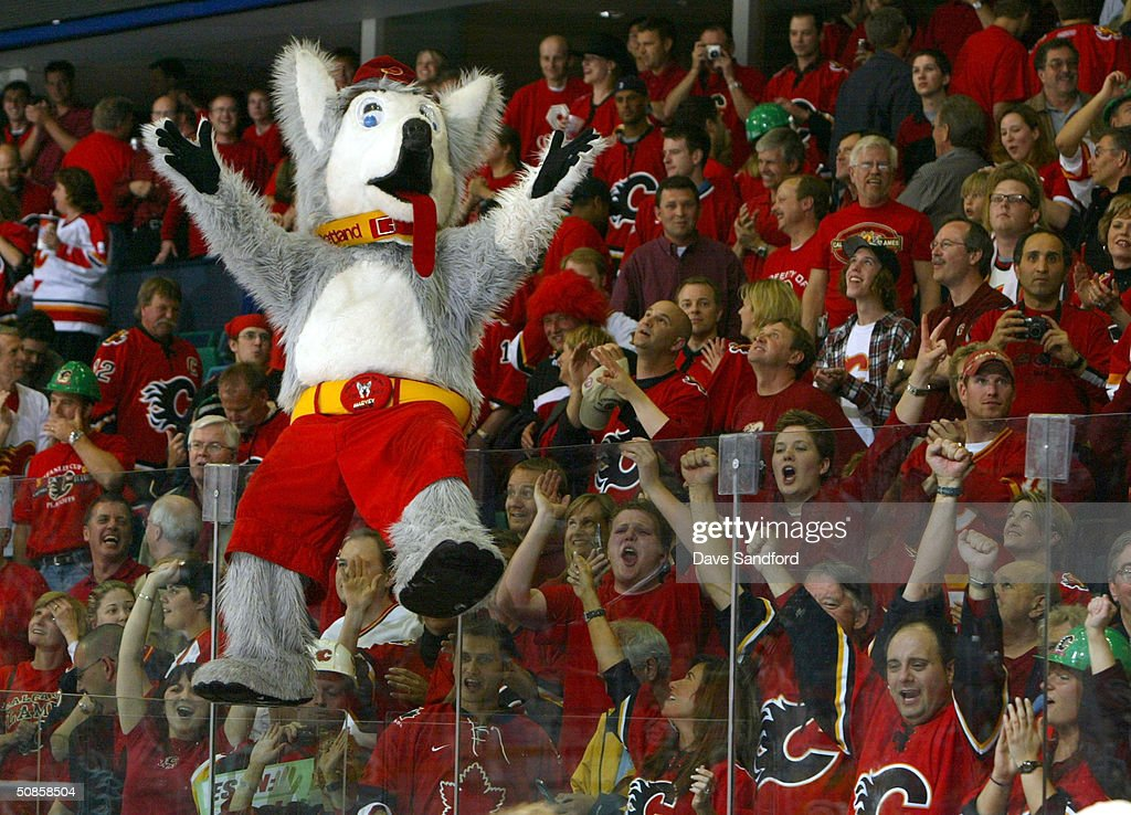 The Calgary Flames mascot 'Harvey the Hound' celebrates with fans after the Flames defeated the San Jose Sharks 3-1 in Game six of the 2004 NHL Western Conference Finals on May 19, 2004 at the Pengrowth Saddledome in Calgary, Alberta.