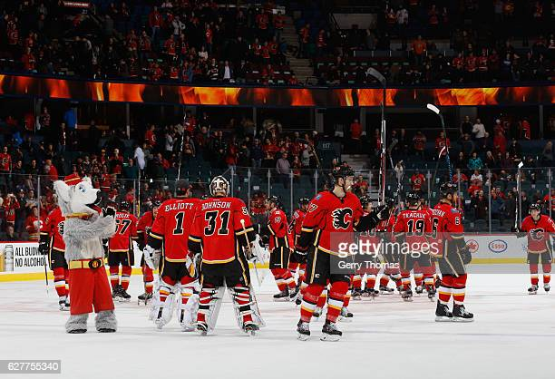 The Calgary Flames salute the C of Red after a win against the Anaheim Ducks at Scotiabank Saddledome on December 4 2016 in Calgary Alberta Canada