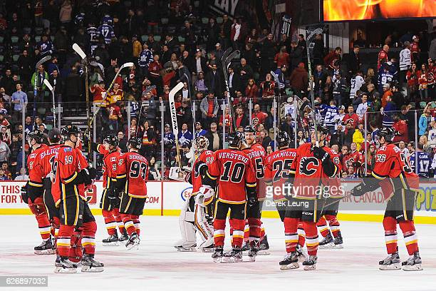 The Calgary Flames salute the crowd after their victory over the Toronto Maple Leafs during an NHL game at Scotiabank Saddledome on November 30 2016...