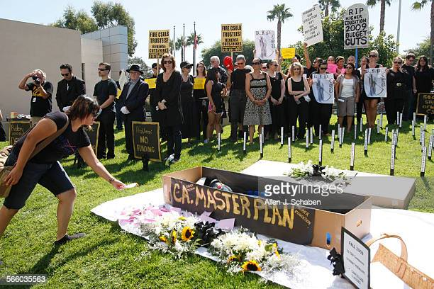 The California Faculty Association and faculty members students and staff from Cal State University Long Beach stage a mock funeral for higher...