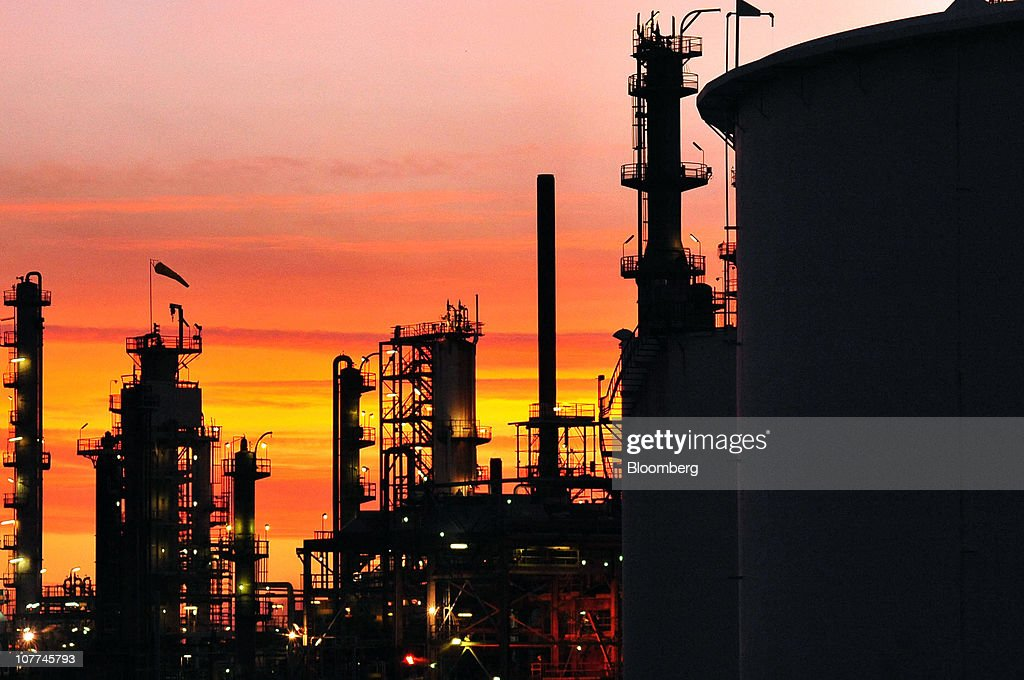 The Caltex Australia Ltd. Lytton refinery is silhouetted against a sunset in Brisbane, Australia, on Tuesday, Dec. 21, 2010. Caltex Australia is the nation's biggest oil refiner. Photographer: Eric Taylor/Bloomberg via Getty Images