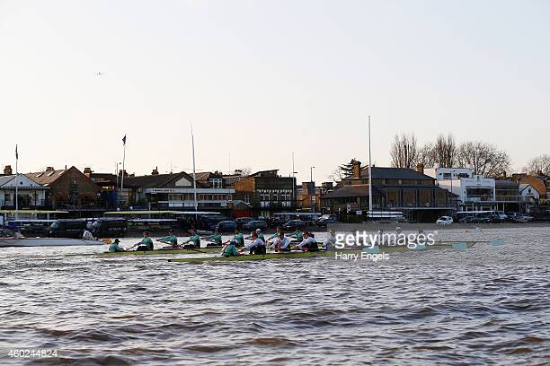 The Cambridge boats 'Not Out' and '63' race past the Putney boathouses during the Cambridge University Boat Club trial eights race on the River...