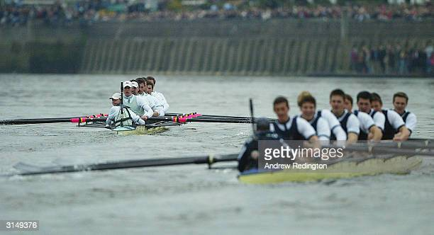 The Cambridge cox Kenelm Richardson looks round as Cambridge pull clear of Oxford to win the Aberdeen Asset Management Trophy at the 150th Boat Race...