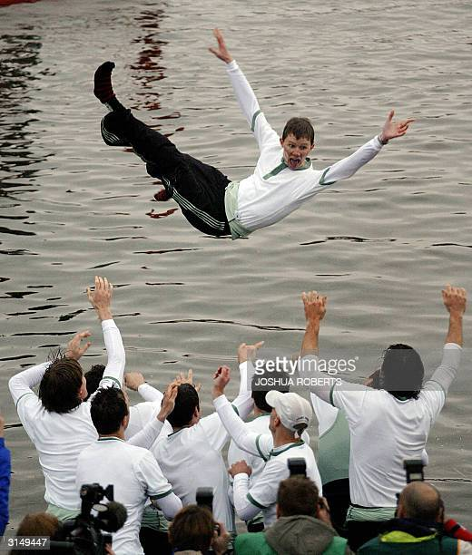 The Cambridge Coxswain Kenelm Richardson is thrown into the Thames River as Cambridge celebrates winning the 150th Boat Race against Oxford 28 March...