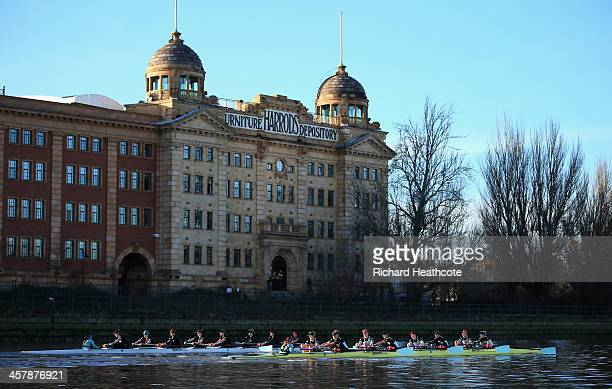 The Cambridge crews of 'Wink Wink' and 'Nudge Nudge' pass the Old Harrods Depository during the Women's University Boat Race Trial 8's race on The...