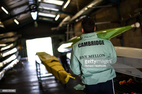 The Cambridge University crew helps to derig the boat after a training row on March 12 2015 in Ely England