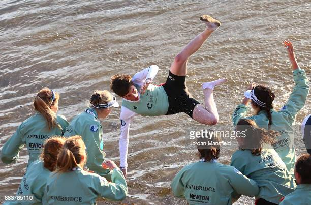 The Cambridge women's crew celebrate winning the Cancer Research UK Women's Boat Race by throwing Matthew Holland cox of The Cambridge women's crew...