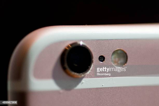 The camera lens component of an Apple Inc iPhone 6s smartphone is seen in an arranged photograph in Hong Kong China on Friday Sept 25 2015 The latest...
