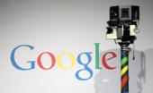 The camera of a German Google Street View car looms over the car next to the Google logo at the Google stand at the CeBIT Technology Fair on March 2...