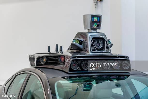 The cameras on a pilot model of an Uber selfdriving car are displayed at the Uber Advanced Technologies Center on September 13 2016 in Pittsburgh...