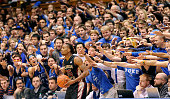 The Cameron Crazies taunt Aaron Thomas of the Florida State Seminoles as he prepares to inbond the ball against the Duke Blue Devils during their...