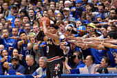 The Cameron Crazies taunt Damion Lee of the Louisville Cardinals during their game against the Duke Blue Devils at Cameron Indoor Stadium on February...