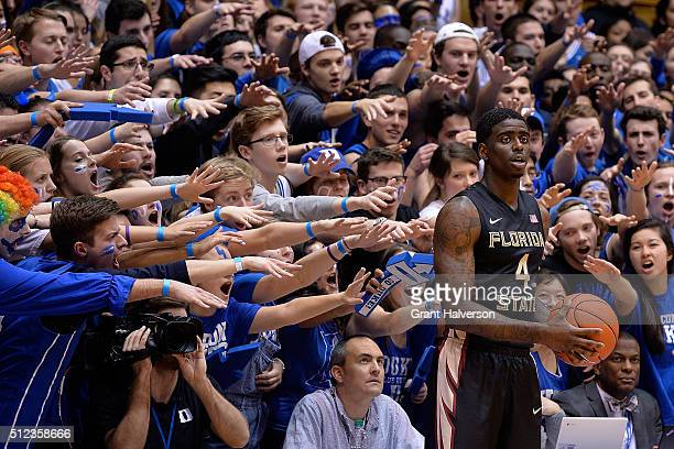 The Cameron Crazies taunt Dwayne Bacon of the Florida State Seminoles during a game against the Duke Blue Devils at Cameron Indoor Stadium on...