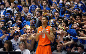The Cameron Crazies taunt Michael Gbinije of the Syracuse Orange as he waits to inbound the ball against the Duke Blue Devils during their game at...