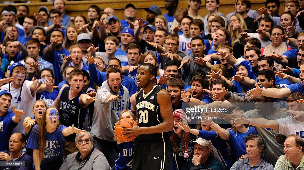 The Cameron Crazies taunt Miles Overton of the Wake Forest Demon Deacons as he prepares to inbound the ball against the Duke Blue Devils during their...