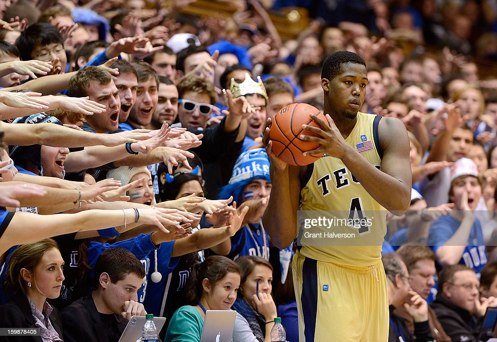 The Cameron Crazies taunt Robert Carter Jr. #4 of the Georgia Tech Yellow Jackets as he inbounds the ball against the Duke Blue Devils during play at Cameron Indoor Stadium on January 17, 2013 in Durham, North Carolina.