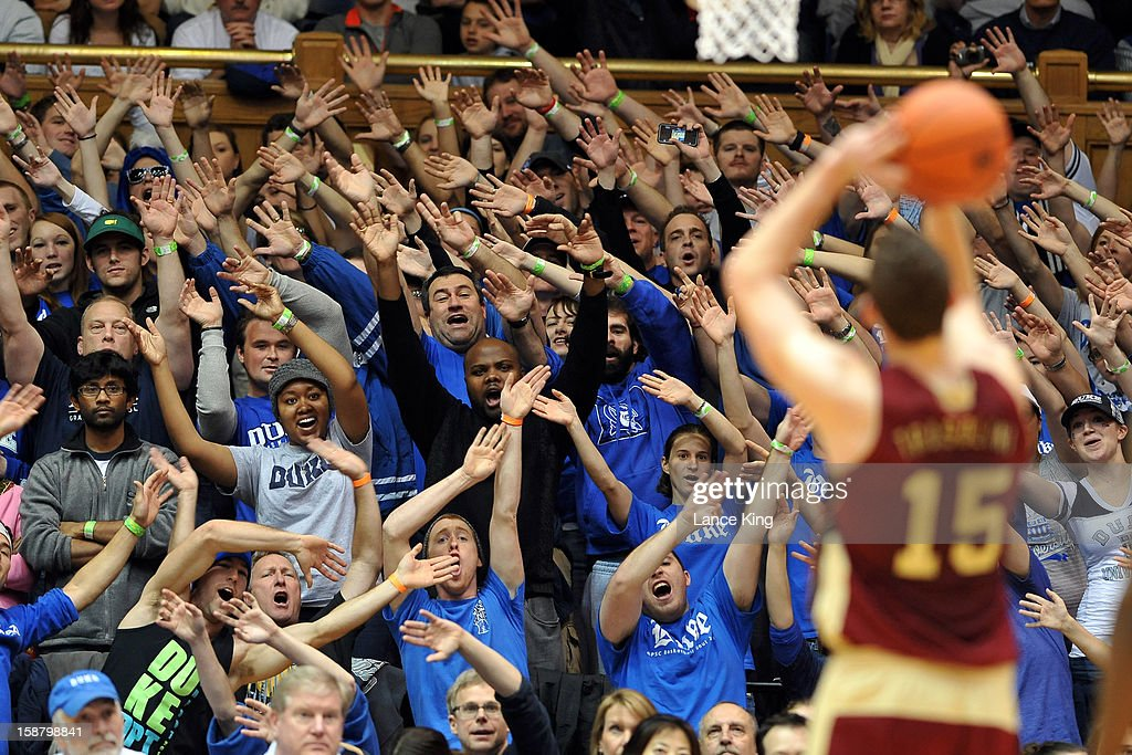 The Cameron Crazies, the Duke Blue Devils student section, try to distract Marc Trasolini #15 of the Santa Clara Broncos at Cameron Indoor Stadium on December 29, 2012 in Durham, North Carolina.