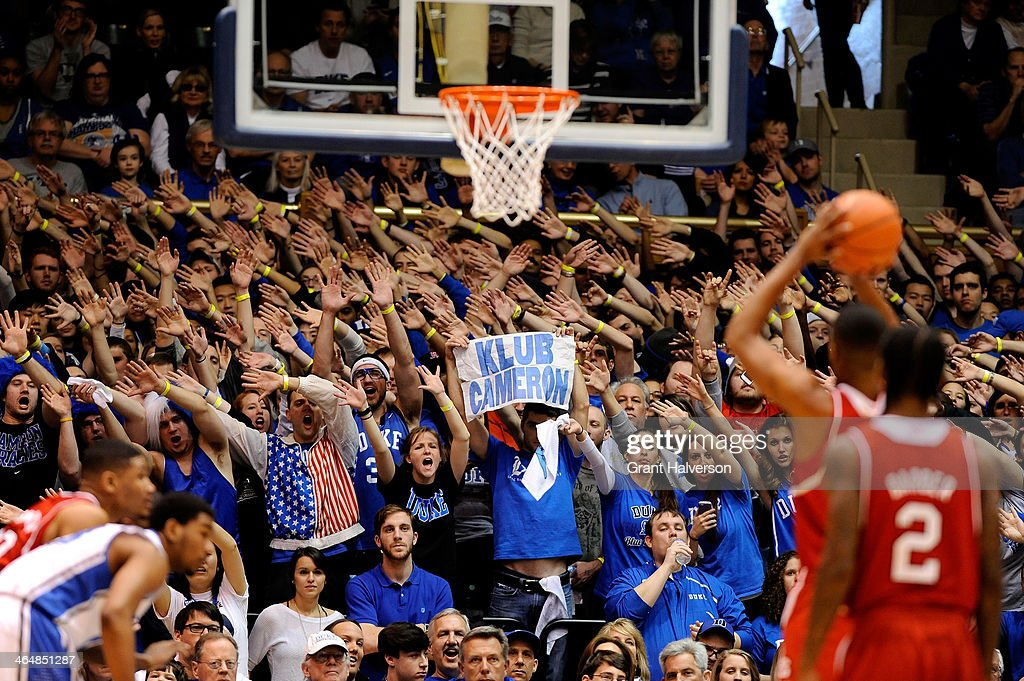 The Cameron Crazies work to disrupt a free throw attempt by the North Carolina State Wolfpack during their game against the Duke Blue Devils at Cameron Indoor Stadium on January 18, 2014 in Durham, North Carolina. Duke won 95-60.