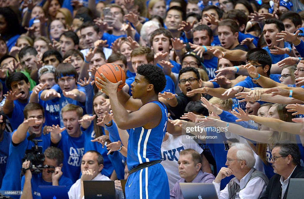 The Cameron Crazis taunt Davon Bell of the Presbyterian Blue Hose as he prepares to inbound the ball against the Duke Blue Devils during their game...
