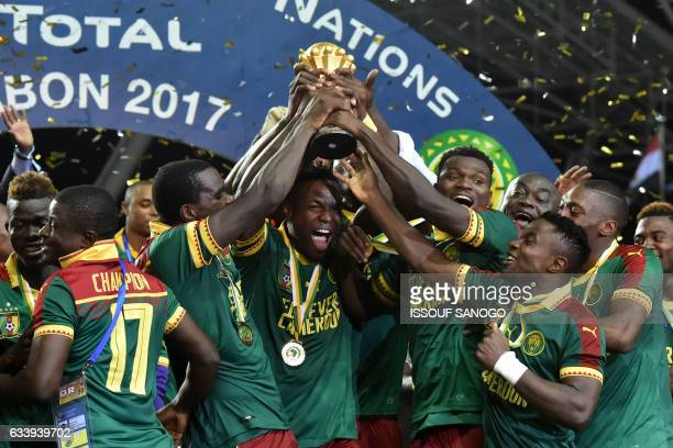 The Cameroon football squad holds up the winner's trophy as they celebrate beating Egypt 21 to win the 2017 Africa Cup of Nations final football...