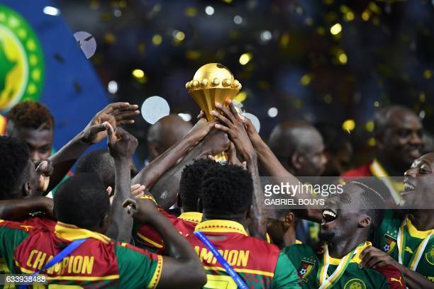 The Cameroon football team celebrate with the winner's trophy after beating Egypt 21 to win the 2017 Africa Cup of Nations final football match...
