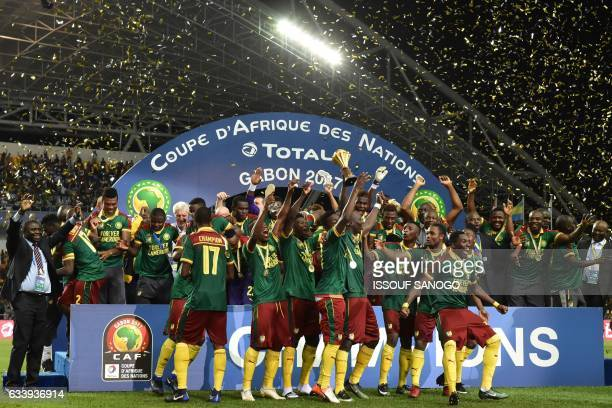 The Cameroon football team celebrates with the trophy after beating Egypt 21 to win the 2017 Africa Cup of Nations final football match between Egypt...