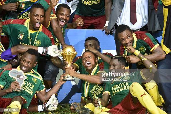TOPSHOT The Cameroon football team celebrates with the trophy after beating Egypt 21 to win the 2017 Africa Cup of Nations final football match...