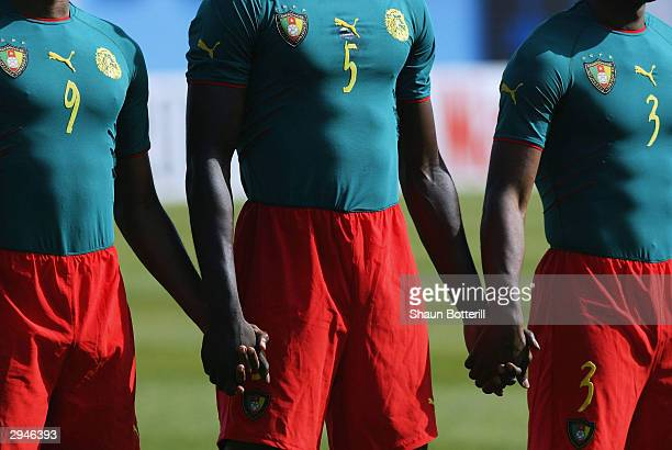 The Cameroon team lineup in their one peace kit before the African Nations Cup 2004 1/4 Final match between Cameroon and Nigeria at the Mustapha Ben...