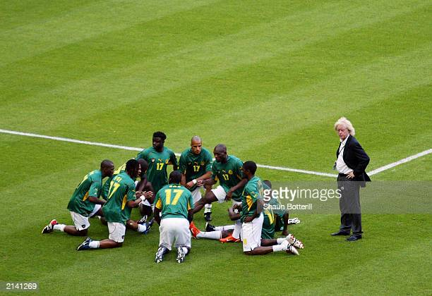 The Cameroon team warmup in MarcVivien Foe shirts in memory of their teammate who tragically died in the previous match before the FIFA...