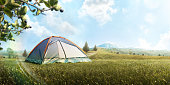 The Camping Tent in mountain in the summer. Tourism. Adventure. Travel. Hike