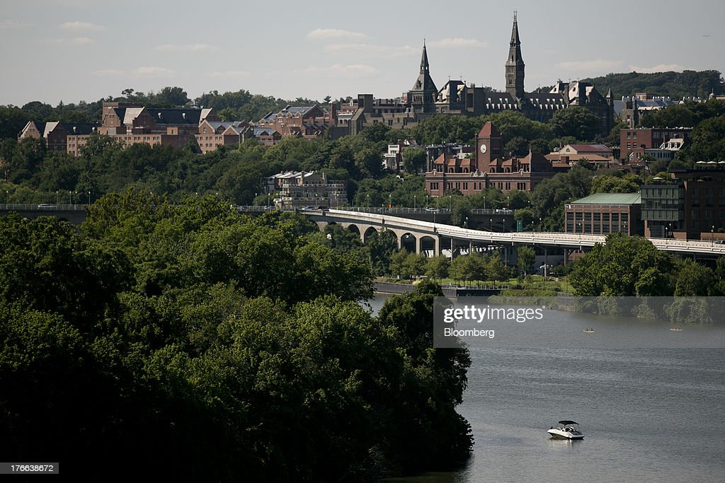 The campus of Georgetown University top right is seen past the Potomac River in Washington DC US on Thursday Aug 15 2013 President Barack Obama and...