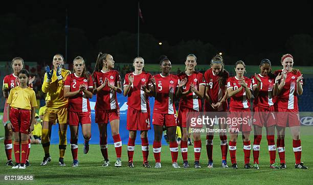 The Canada players applaud their anthem prior to the FIFA U17 Women's World Cup Jordan 2016 Group B match between Germany and Canada at Amman...