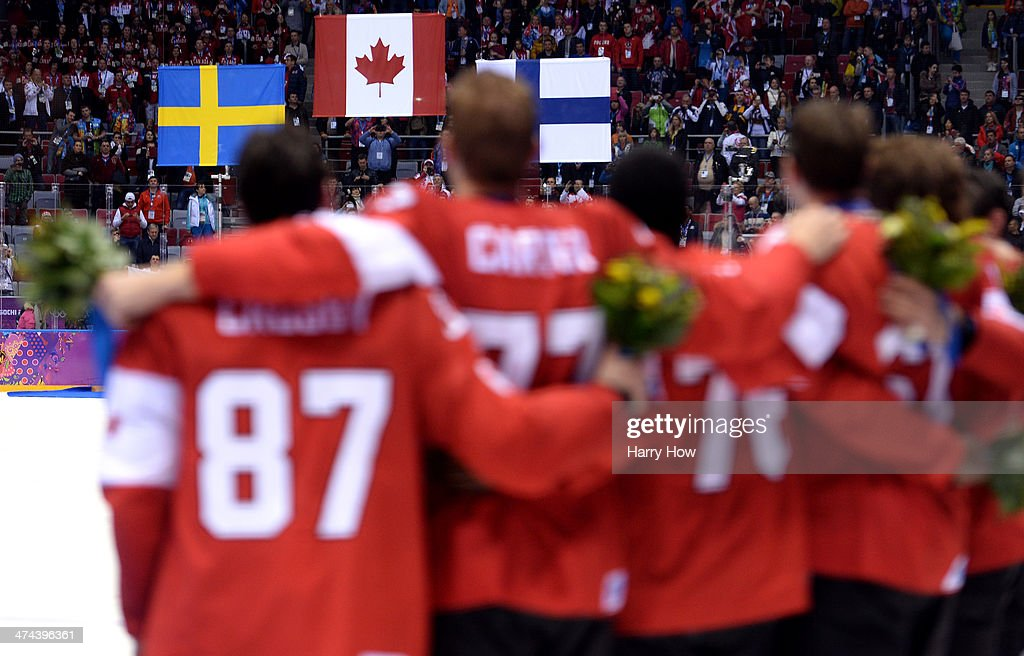 The Canada team listen to the national anthem after recieving their gold medals won during the Men's Ice Hockey Gold Medal match against Sweden on Day 16 of the 2014 Sochi Winter Olympics at Bolshoy Ice Dome on February 23, 2014 in Sochi, Russia.