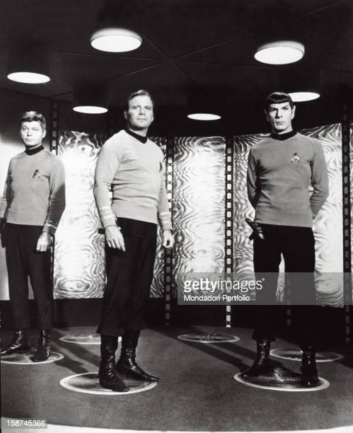 The Canadian actor William Shatner and the American actors Jackson DeForest Kelley and Leonard Nimoy standing inside the Starship Enterprise in a...
