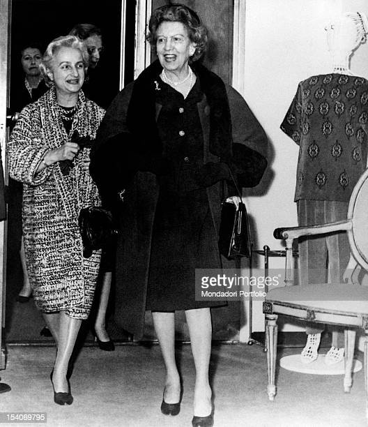 The Canadian businesswoman Elizabeth Arden smiles in the company of a friend March 1962